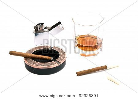 Cigarillos, Ashtray, Lighter And Whiskey