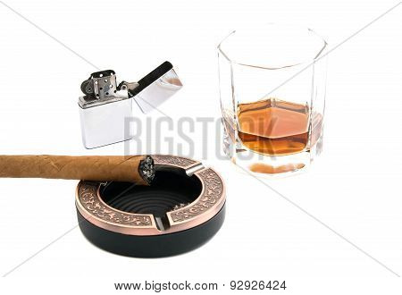 Cigar In Ashtray And Glass Of Whiskey