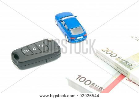 Car Keys, Blue Car And Euro Notes On White