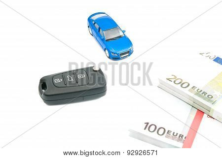 Blue Car, Black Car Keys And Euro Banknotes