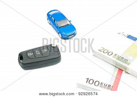 Blue Car, Black Car Keys And Euro Notes