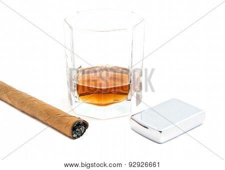 Cigar, Lighter And Glass Of Cognac
