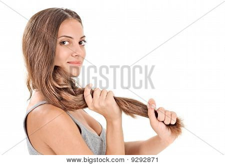 Young Brunette Beautiful Lady Playing With Long Hairs On White
