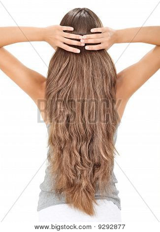 Brunette Lady Holding Long Hairs, View From Back Side Isolated On White