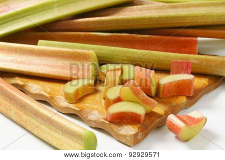 detail of fresh cut rhubarb on wooden cutting board