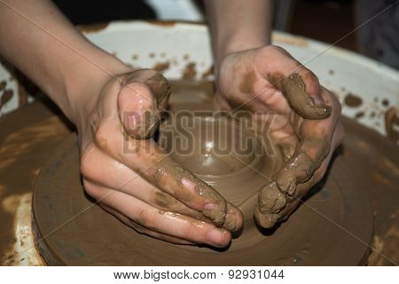 the clay pot is made children's hands