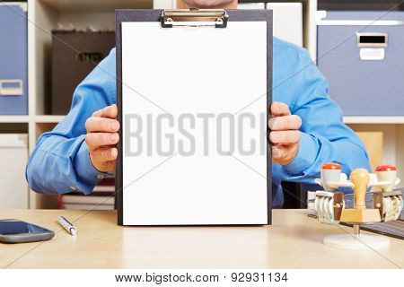 Man holding clipboard with empty piece of white paper