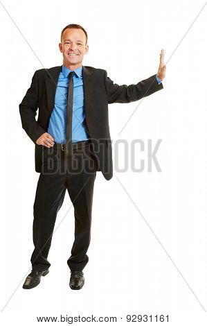 Smiling full body business man leaning isolated on imaginary wall