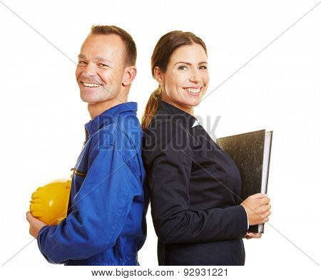 Happy man as worker and woman as business professional leaning back to back