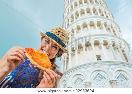 Closeup Of Woman Holding And Biting Slice Of Pizza In Pisa