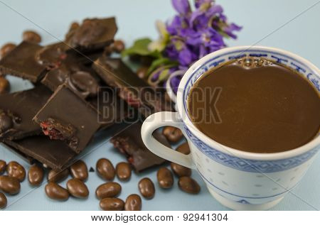 Dark Chocolate With Raisins, Chocolate Balls And A Cup Of Coffee