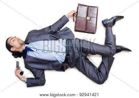 Businessman on the floor isolated on white