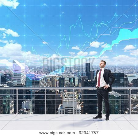 Trader On The Roof In New York City. Forex Chart Over The Sky. A Concept Of Prosperous Portfolio Man