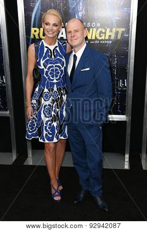NEW YORK-MAR 9: Composer Tom Holkenborg (R) and wife Saskia attend the premiere of
