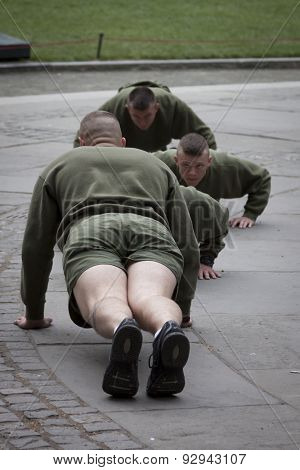 NEW YORK - MAY 21 2015: US Marines doing push ups during an early morning boot camp exercise in Bryant Park at Marine Day during Fleet Week NY 2015.