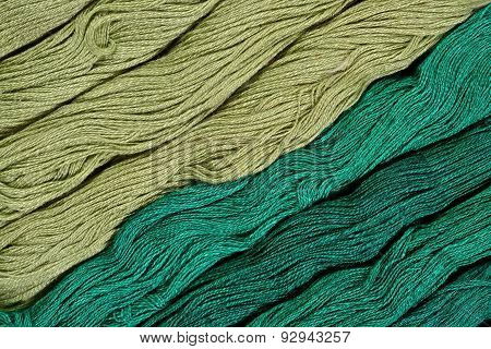 Green Skeins Of Floss As Background Texture