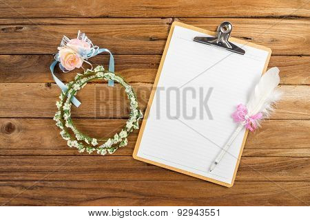 Clipboard Attach Planning Paper With Pen Beside Rose Headband