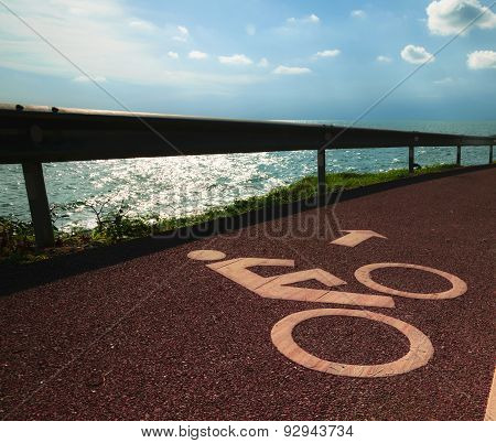 Red Bicycle Lane Along The Coastal Road