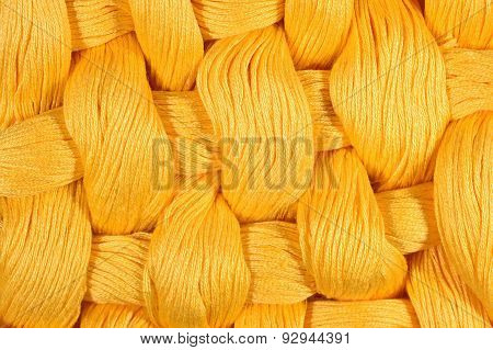 Yellow Twisted Skeins Of Floss As Background Texture