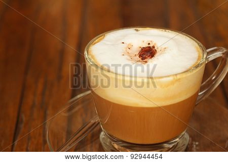 Espresso Coffee Hot In A Glass On A Background Of Wood