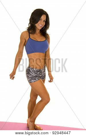 Woman Fitness Shorts And Bra Stand Looking Hands Down