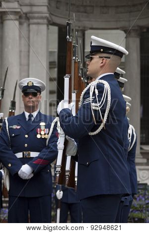 NEW YORK - MAY 21 2015: Members of the US Coast Guard Ceremonial Honor Guard Silent Drill Team perform next to the New York Public Library in Bryant Park during Fleet Week NY 2015.