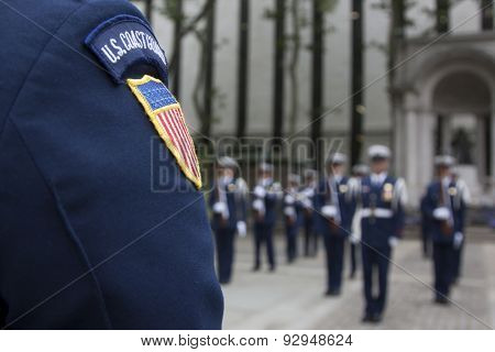NEW YORK - MAY 21 2015: Close-up of the US Coast Guard patch on the shoulder of a member of the Ceremonial Honor Guard Silent Drill Team during their performance in Bryant Park during Fleet Week NY.