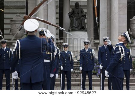 NEW YORK - MAY 21 2015: The US Coast Guard Ceremonial Honor Guard Silent Drill Team perform an air-toss movement of rifles with fixed bayonets in Bryant Park during Fleet Week NY.