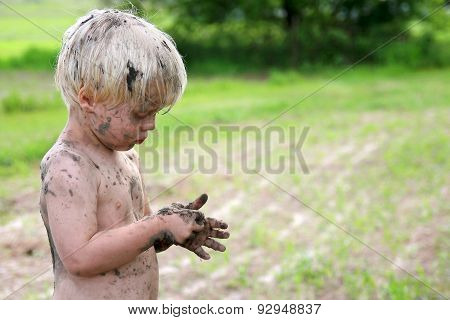 Cute Dirty Child Playing Outside In The Country
