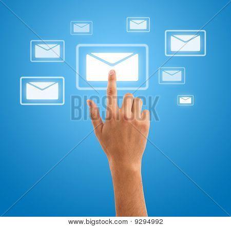 Hand Pressing Futuristic Mail Symbol On Blue Background