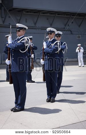 NEW YORK - MAY 22 2015: The US Coast Guard Ceremonial Honor Guard Silent Drill Team perform on Pier 92 next to the Intrepid Sea, Air, and Space Museum during Fleet Week NY 2015.
