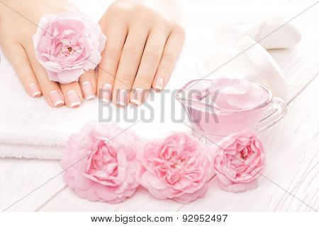 french manicure with rose flowers. spa
