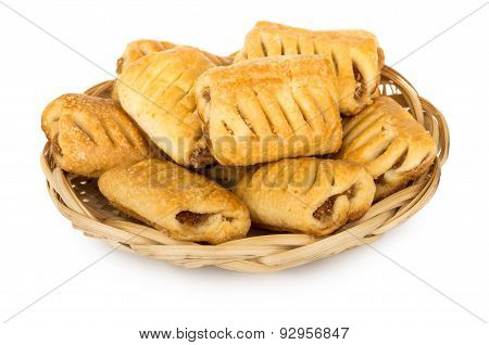 Mini Strudels In Wicker Basket Isolated On White