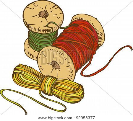 Three Color Spools of Thread