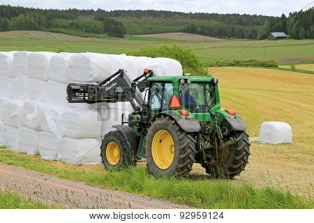 Farmer Stacks Up Silage With Front Loader John Deere 6330 Tractor