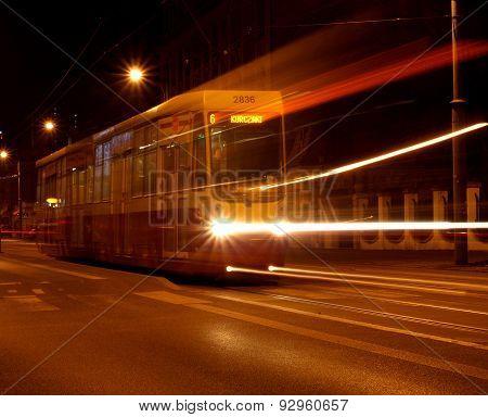 Tram driving on a street in Lodz.
