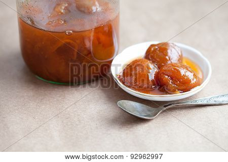 Apricot Jam In A Glass Jar And Plate