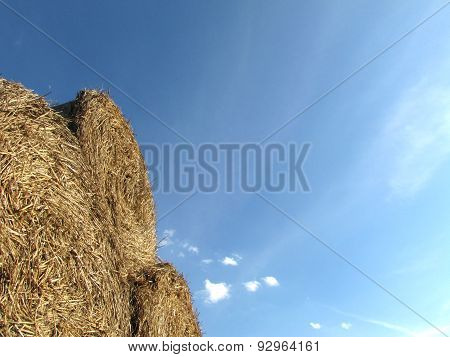 Three Bale Of Hay With A Nice Blue Sky And Amazing Sunlight