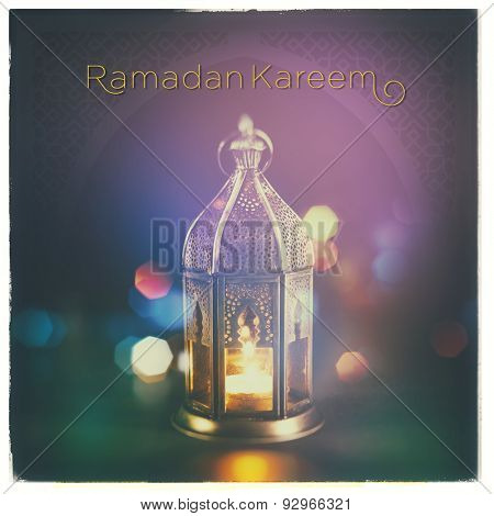 'Ramadan Kareem'. A beautiful greeting card with english headline over islamic lamp background.
