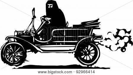 Woman In Hijab Or Burka Driving A Car