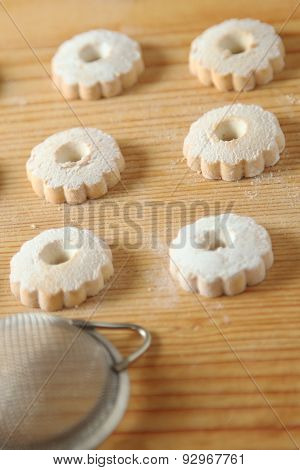 Italian Canestrelli Biscuits With A Strainer For Powdered Sugar