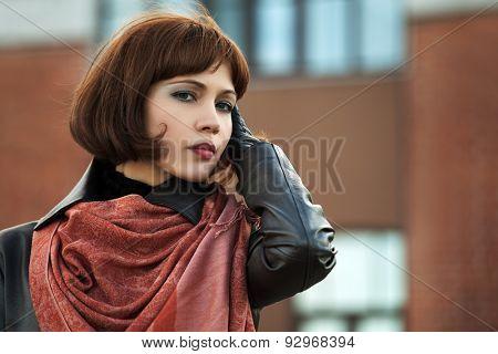 Portrait of sad beautiful fashion woman outdoor