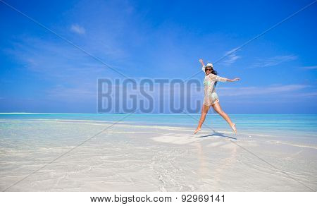 Young girl having fun on tropical white  beach