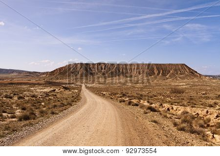 Dirt track through desert