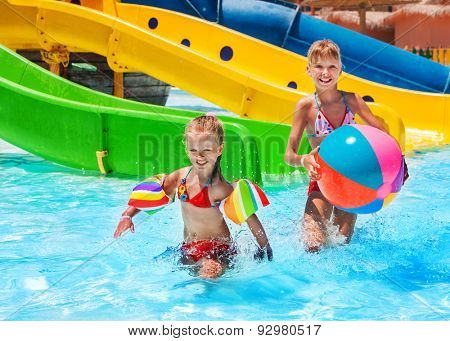 Child in water at aquapark. Summer holiday lifestyle.