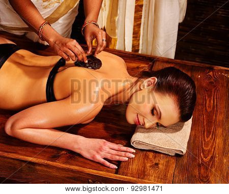 Young woman having spa massage.