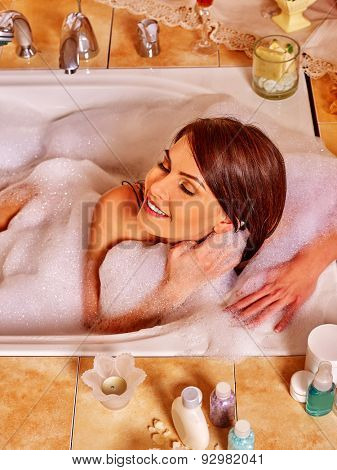 Woman relaxing at home luxury foam bath. Top view.