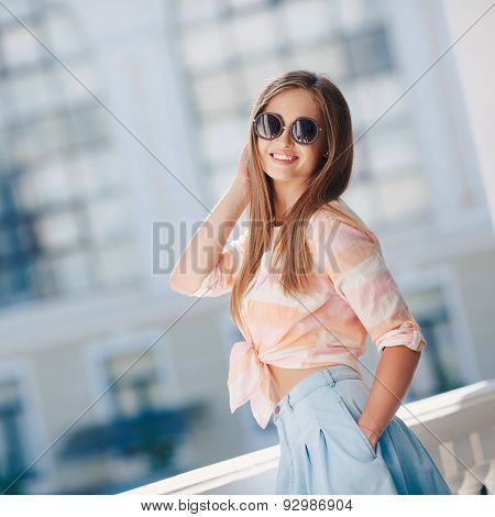Beautiful girl on the background of the city