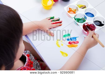 Asian Girl Doing Fingerprints Using Drawing Tools, Art Education And Creativity Concept
