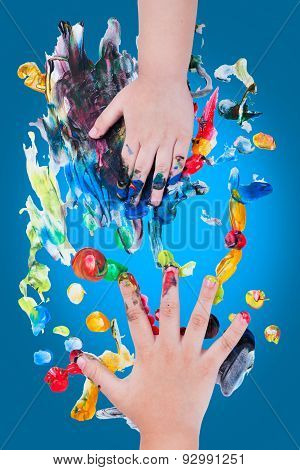 Closeup Of Little Children Hands Doing Finger Painting With Various Colors
